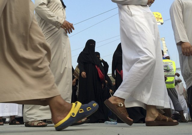 Muslim pilgrims make their way to throw stones at a pillar, symbolizing the stoning of Satan in a ritual called Jamarat, the last rite of the annual hajj, in the Mina neighborhood of Mecca, Saudi Arabia, Sunday, Oct. 5, 2014
