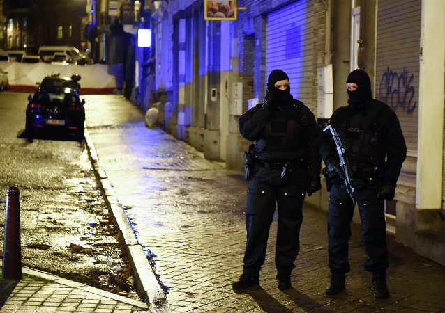 Police stands guard in Verviers, eastern Belgium, on January 15, 2015, after two men were reportedly killed during an anti-terrorist operation