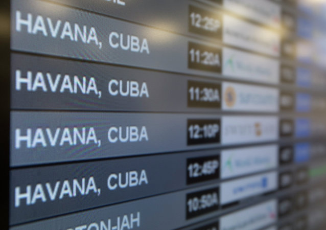 Charter flights from Miami to Havana are shown on a departures monitor at Miami International Airport, Friday, Jan. 16, 2015 in Miami
