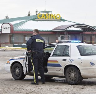 Police contain the scene where two RCMP officers were shot in St. Albert, Alberta, Canada, on Saturday, Jan. 17, 2015