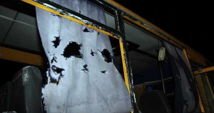 A view of the shattered windows and the torn curtains of a bus hit during shelling