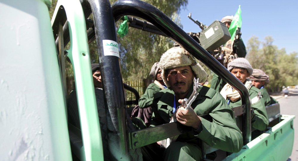 Shi'ite Houthi fighters ride a truck