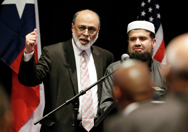 Imam Abdul Malik Mujahid, left, and Iman Zia Sheikh, right, address attendees of a muslim conference at the Curtis Culwell Center, Saturday, Jan. 17, 2015, in Garland, Texas.