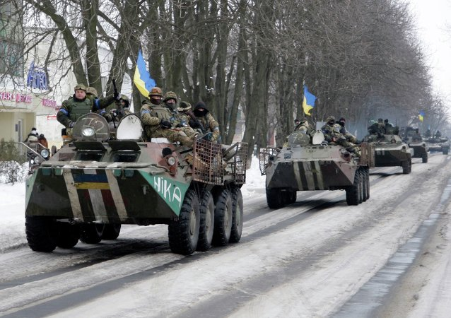 Members of the Ukrainian armed forces drive armored vehicles in the town of Volnovakha, eastern Ukraine, January 18, 2015.