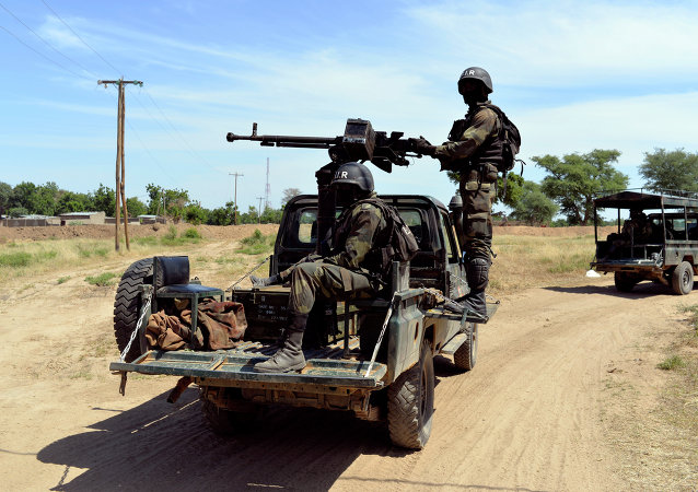 Cameroonian soldiers patrol in Amchide, northern Cameroon, 1 km from Nigeria