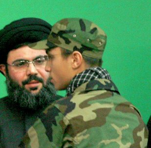 Jihad Moughniyah (R), son of Lebanon's Hezbollah late military leader Imad Moughniyah, greets Sayyed Hashem Safieddine, head of Hezbollah's Executive Council, as they attend a ceremony marking a week of his father's death in Beirut's suburbs in this February 22, 2008 file photo.