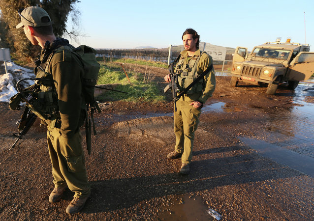 Israeli troops patrol the Israeli-occupied sector of the Golan Heights on January 18, 2015.