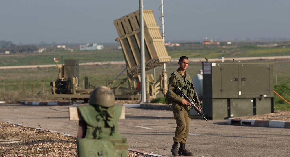 An Israeli soldier guards an Iron Dome air defense system deployed in the Israeli controlled Golan Heights near the border with Syria, Tuesday, Jan. 20, 2015.