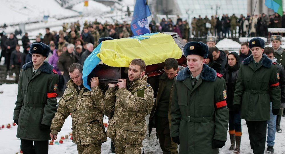 Servicemen from the battalion Aydar carry a coffin bearing the body of their comrade Sergiy Nikonenko