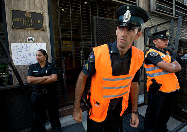 Police officers stand guard outside the prosecutor's office that leads the investigation into the death of Alberto Nisman, a prosecutor found dead in his apartment, in Buenos Aires, Argentina, Friday, Jan. 23, 2015