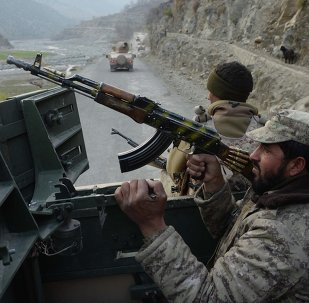 In this picture taken on January 3, 2015, Afghan security personnel patrol during an ongoing anti-Taliban operation in Dangam district near the Pakistan-Afghanistan border in the eastern Kunar province
