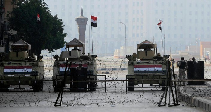 Armoured vehicles and barbed wire block an entrance to Tahrir Square during the 4th anniversary of the January 2011 uprising, in Cairo January 25, 2015