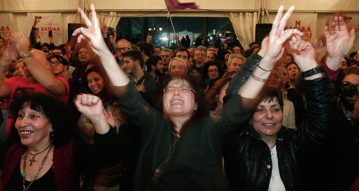 Supporters of the leftist SYRIZA Party celebrating their election victory in Athens, January 25, 2015