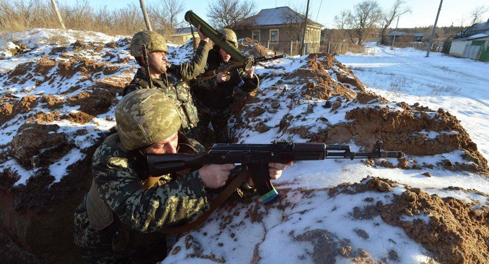 Ukrainian servicemen guard their position in the village of Luhanska, Luhansk region