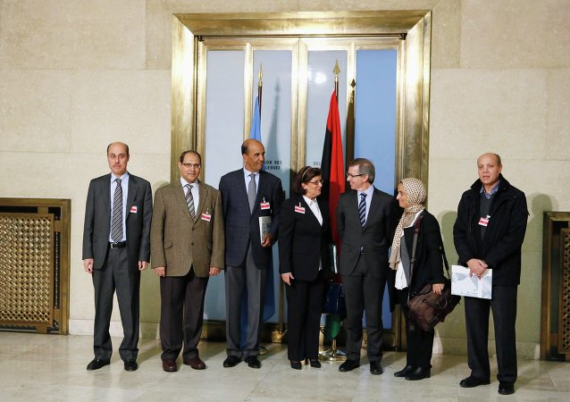 Special Representative of the U.N. Secretary-General for Libya and Head of United Nations Support Mission in Libya (UNSMIL) Bernardino Leon (3rd R) poses with Civil Society Representatives and former members of the National Transitional Council, for a group photograph after a news conference at the Palais des Nations in Geneva