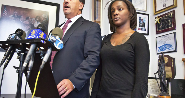 Attorney Scott Rynecki, left, and Kimberly Ballinger, the domestic partner of Akai Gurley and mother of his toddler daughter, hold a press conference, Thursday, Jan. 29, 2015