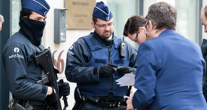 Police checks the identity of people who want to enter a government building in Brussels.