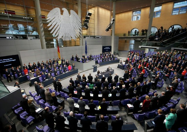 German Chancellor Angela Merkel, members of government and parliament observe a minute of silence to commemorate the victims of the attack at the Paris offices of French weekly satirical newspaper Charlie Hebdo