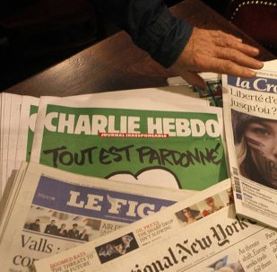 Copies of the latest issue of Charlie Hebdo newspaper are sold with other newspapers at a newsstand in Lille, northern France