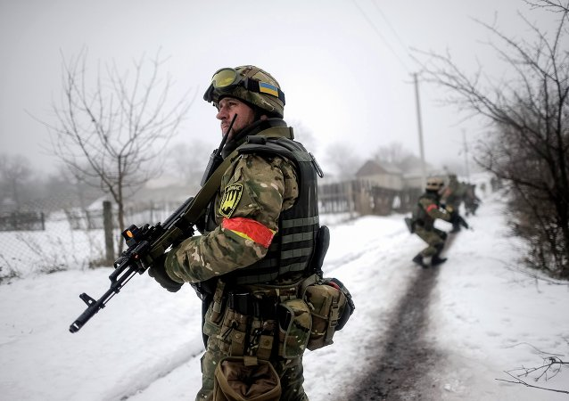 File Photo: Ukrainian servicemen patrol Orekhovo village in Luhansk region January 28, 2015