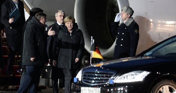 German Chancellor Angela Merkel is welcomed at Vnukovo-2 airport