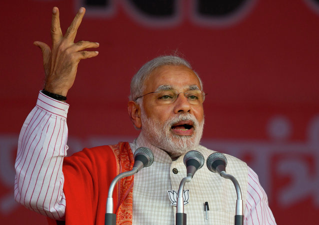 Indian Prime Minister Narendra Modi addresses an election campaign rally for his Bharatiya Janata Party (BJP) ahead of Delhi state election in New Delhi, India, Wednesday, Feb. 4, 2015