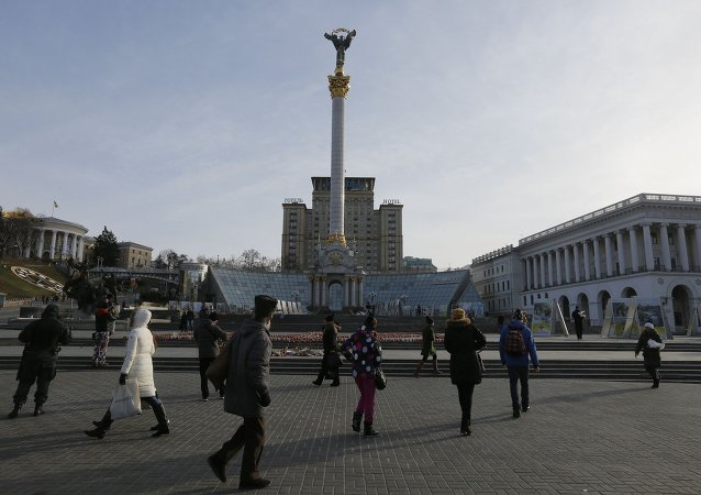 Ukrainians walking past candles in the shape of the national emblem of Ukraine on Independence Square in Kiev, Ukraine