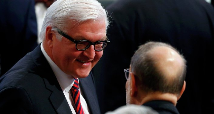 German Foreign Minister Frank-Walter Steinmeier (L) arrives for the chairman's debate during the 51st Munich Security Conference at the 'Bayerischer Hof' hotel in Munich February 8, 2015