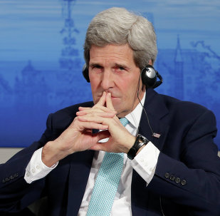U.S. Secretary of State John Kerry listens to a speech of German Foreign Minister Frank-Walter Steinmeier on the podium during the 51. Security Conference in Munich, Germany, Sunday, Feb. 8, 2015