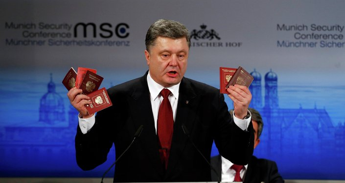 Ukrainian President Petro Poroshenko holds Russian passports meant to prove the presence of Russian troops in Ukraine as he addresses the 51st Munich Security Conference, February 7, 2015
