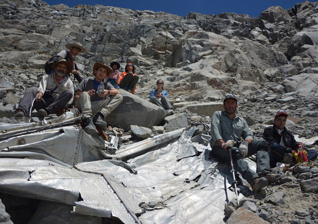 A group of Chilean mountaineers pose for a photo on what they say is the wreckage of a plane that crashed in the Andes 54 years ago