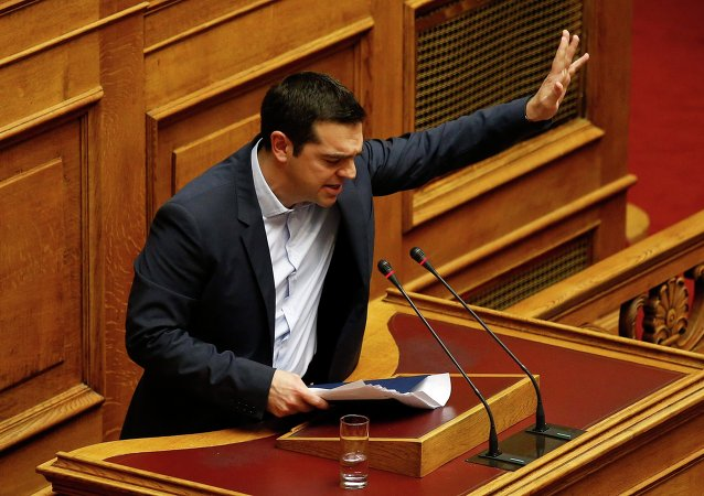 Greek Prime Minister Alexis Tsipras waves to lawmakers following his first major speech in parliament in Athens February 8, 2015.