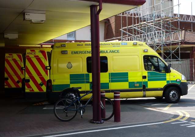 A row of NHS West Midlands Ambulance Service emergency ambulances, outside the Accident & Emergency department of Warwick Hospital.
