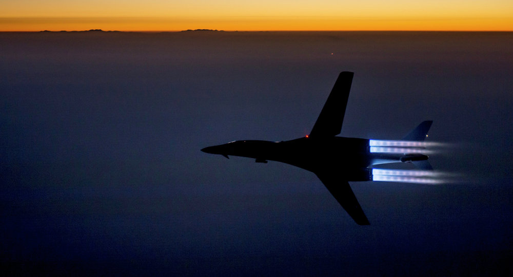 In this Saturday, September 27 photo released by the U.S. Air Force, a fighter jet flies over northern Iraq after conducting airstrikes in Syria against Islamic State group targets in Syria.