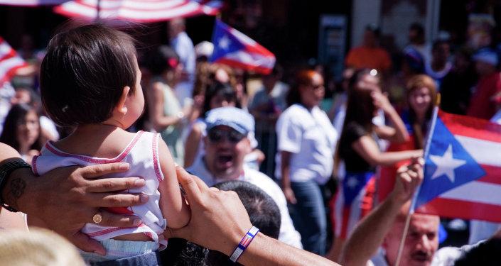 A kid takes in Las Fiestas Puertorriqueñas along Division Street in Humboldt Park.