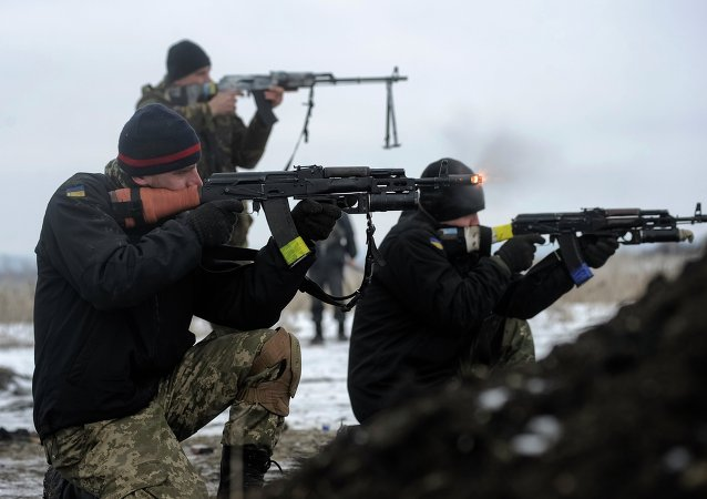 Ukrainian servicemen train with weapons