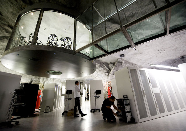 A man walks inside the Pionen high-security computer storage facility of Swedish Bahnhof , one of the companies to host WikiLeaks servers in Stockholm, Sweden. (File)