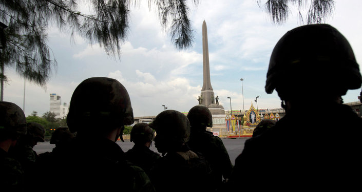 Thai soldiers stand guard at Victory Monument in Bangkok, Thailand