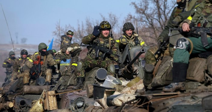 Members of the Ukrainian armed forces ride on armoured personnel carriers (APC) near Debaltseve, eastern Ukraine, February 12, 2015