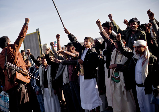 Houthi Shiite Yemenis chant slogans during a rally to show support for their comrades in Sanaa, Yemen, Wednesday, Jan. 28, 2015