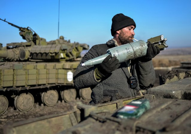 A Ukrainian serviceman loads ammunition into a tank in the territory controlled by Ukraine's government forces, Donetsk region February 13, 2015