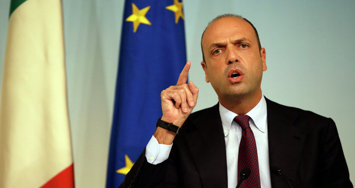 In this Friday, Oct. 31, 2014 file photo, Italian Interior Minister Angelino Alfano meets journalists during a press conference to present the EU 'Tritone' migrants rescue mission, in Rome's Palazzo Chigi government office