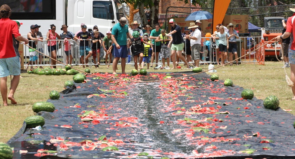 The world-famous biannual Chinchilla Melon Festival in Australia attracted a record number of visitors. Above: Melon skiing.