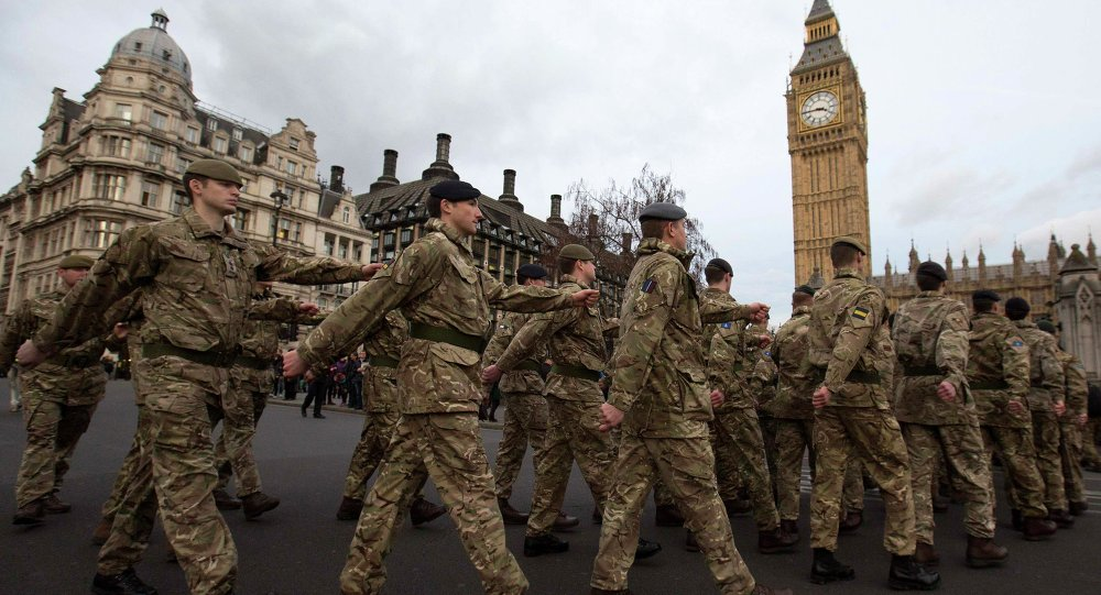 Members of Britain's armed forces march from Wellington Barracks to The Houses of Parliament during the final March Into Parliament for Operation Herrick in London January 26, 2015