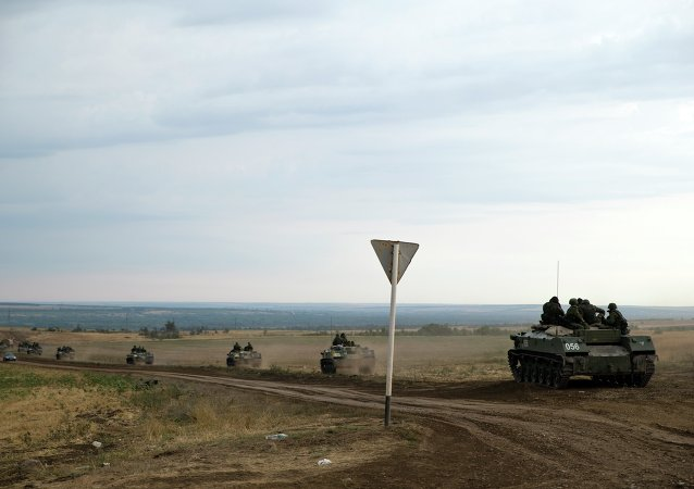 A number of Russian APC's move in a field in about 10 kilometers from the Russia-Ukrainian border control point near the town of Donetsk, Rostov-on-Don region, Russia, Monday, Aug. 18, 2014. File Photo.