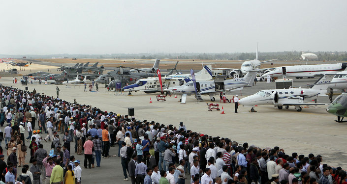 Visitors look at aircraft parked at the static display area on the third day of Aero India 2013 at Yelahanka Air Force station in Bangalore on February 8, 2013. File photo