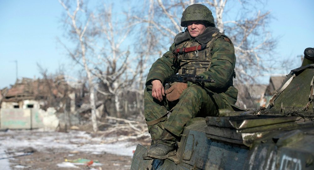 Independence supporter of self-proclaimed Donetsk People's Republic army sits on top of an armoured personnel carrier in the village of Nikishine, south east of Debaltseve February 17, 2015