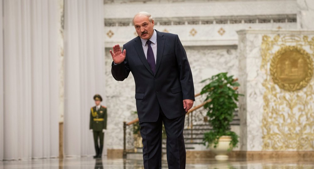 BelarusPresident, Alexander Lukashenko, greets journalists as he comes to attend the arrival ceremony in Minsk, Belarus, Wednesday, Feb. 11, 2015