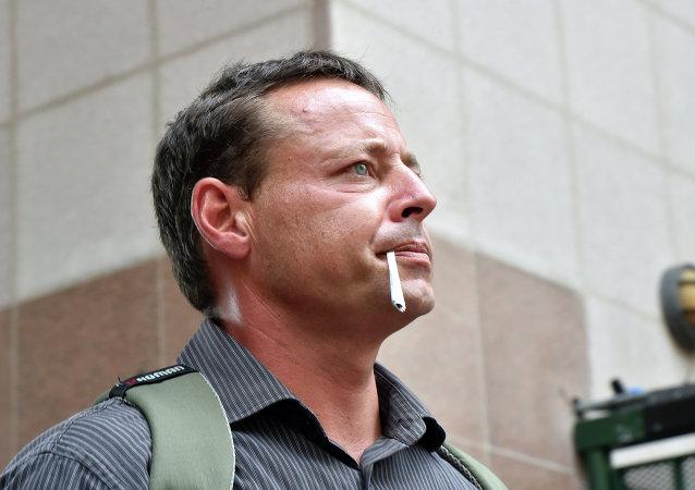Former Australian Guantanamo Bay inmate David Hicks leaves following his talks with the media at Circular Quay in Sydney