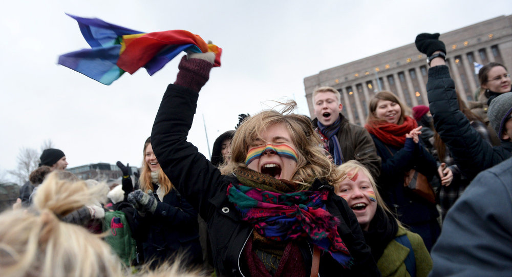 Supporters of the same-sex marriage celebrate outside the Finnish Parliament in Helsinki, Finland